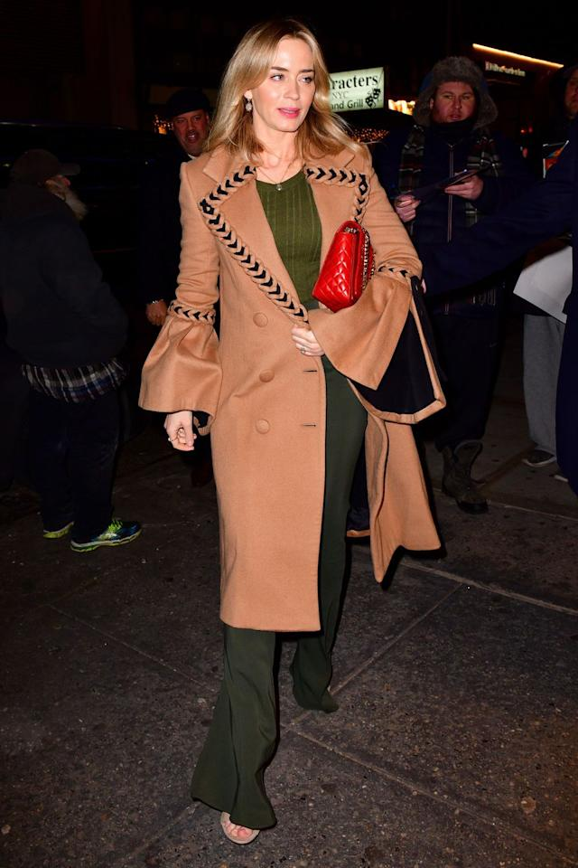 """<p><strong>10 January</strong> Emily Blunt was spotted out in New York wearing wide-leg trousers and a <a rel=""""nofollow"""" href=""""https://www.harpersbazaar.com/uk/fashion/what-to-wear/news/g37285/best-camel-coats/"""">camel coat</a> with flared sleeves.</p><p><a rel=""""nofollow"""" href=""""https://www.harpersbazaar.com/uk/fashion/what-to-wear/news/g37285/best-camel-coats/"""">SHOP CAMEL COATS</a></p>"""