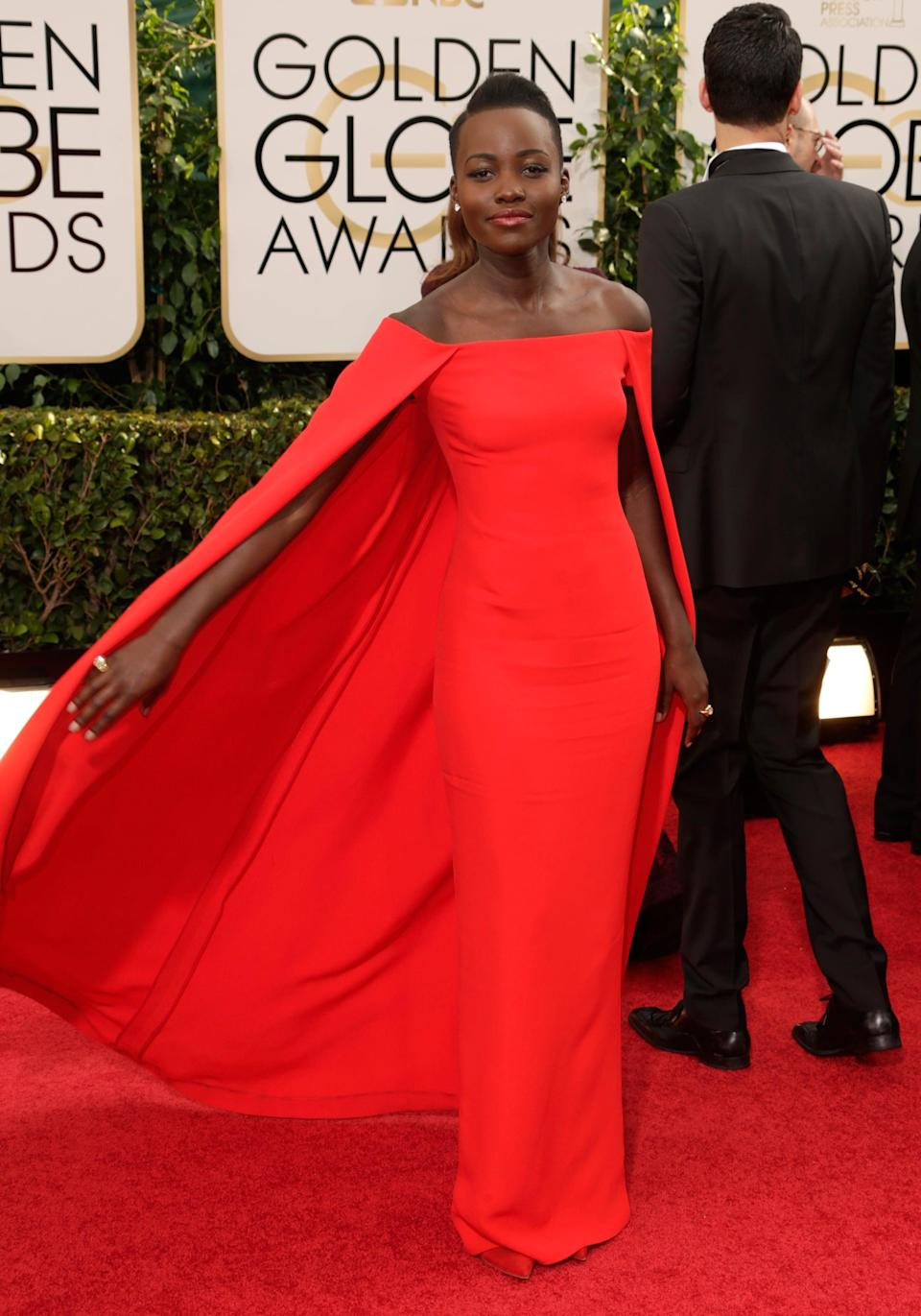 <p>Lupita wore a Ralph Lauren Collection scarlet gown and Fred Leighton jewels to the 2014 Golden Globe Awards.</p>