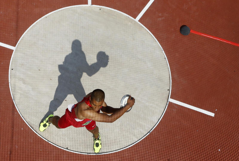 The United State's Ashton Eaton competes in the men's decathlon discus throw event at the London 2012 Olympic Games at the Olympic Stadium, Thursday, Aug. 9, 2012, in London. (AP Photo/Pawel Kopczynski, Pool)