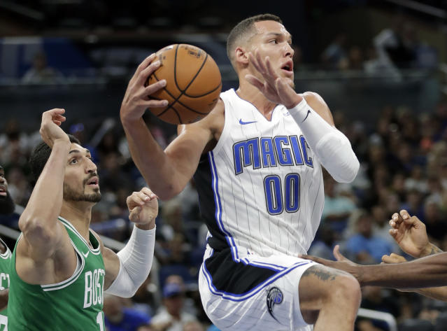 Orlando Magic's Aaron Gordon (00) looks to pass the ball as he is guarded by Boston Celtics' Enes Kanter, left, during the first half of an NBA preseason basketball game, Friday, Oct. 11, 2019, in Orlando, Fla. (AP Photo/John Raoux)