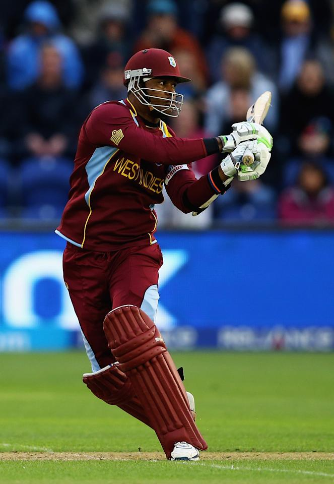 CARDIFF, WALES - JUNE 14:  Marlon Samuels of the West Indies pulls the ball towards the boundary during the ICC Champions Trophy Group B match between West Indies and South Africa at SWALEC Stadium on June 14, 2013 in Cardiff, Wales.  (Photo by Matthew Lewis-ICC/ICC via Getty Images)