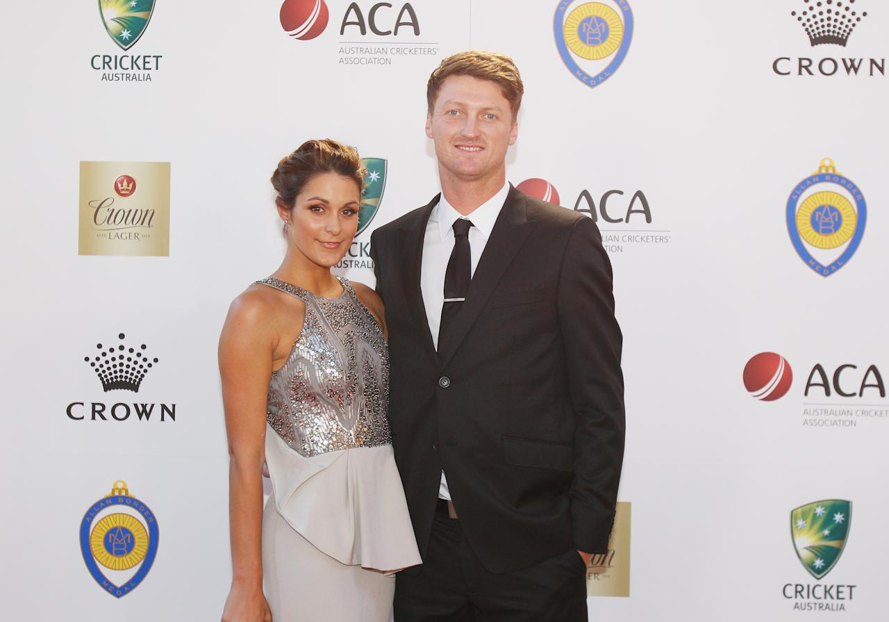 MELBOURNE, AUSTRALIA - FEBRUARY 04:  Jackson Bird of Australia and his partner Laura Ellis arrive at the 2013 Allan Border Medal awards ceremony at Crown Palladium on February 4, 2013 in Melbourne, Australia.  (Photo by Scott Barbour/Getty Images)