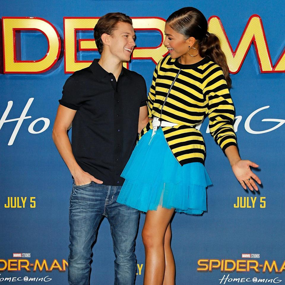 """<ul> <li><strong>What to wear for Tom: </strong>Now that we know <a href=""""https://www.popsugar.com/celebrity/zendaya-and-tom-holland-relationship-timeline-48412133"""" class=""""link rapid-noclick-resp"""" rel=""""nofollow noopener"""" target=""""_blank"""" data-ylk=""""slk:Tom Holland and Zendaya may be dating"""">Tom Holland and Zendaya may be dating</a>, dressing as the Spider-Man costars would be a fun couple costume. To copy Tom's throwback red carpet look, wear a black collared polo shirt and jeans. </li> <li><strong>What to wear for <a class=""""link rapid-noclick-resp"""" href=""""https://www.popsugar.com/Zendaya"""" rel=""""nofollow noopener"""" target=""""_blank"""" data-ylk=""""slk:Zendaya"""">Zendaya</a>: </strong>Stand out from the crowd in a yellow-and-black striped sweater and blue tulle skirt. Accessorize with a white belt and heels to really capture <a class=""""link rapid-noclick-resp"""" href=""""https://www.popsugar.com/Zendaya"""" rel=""""nofollow noopener"""" target=""""_blank"""" data-ylk=""""slk:Zendaya"""">Zendaya</a>'s style from this <strong>Spider-Man: Homecoming</strong> premiere in 2017.</li> </ul>"""