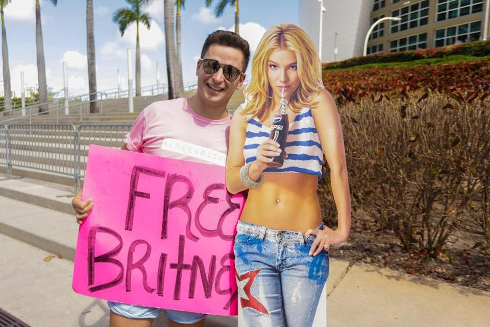 A supporter of Britney Spears holds a sign during a #FreeBritney protest outside American Airlines Arena on February 11, 2021 in Miami, Florida. (John Parra/Getty)