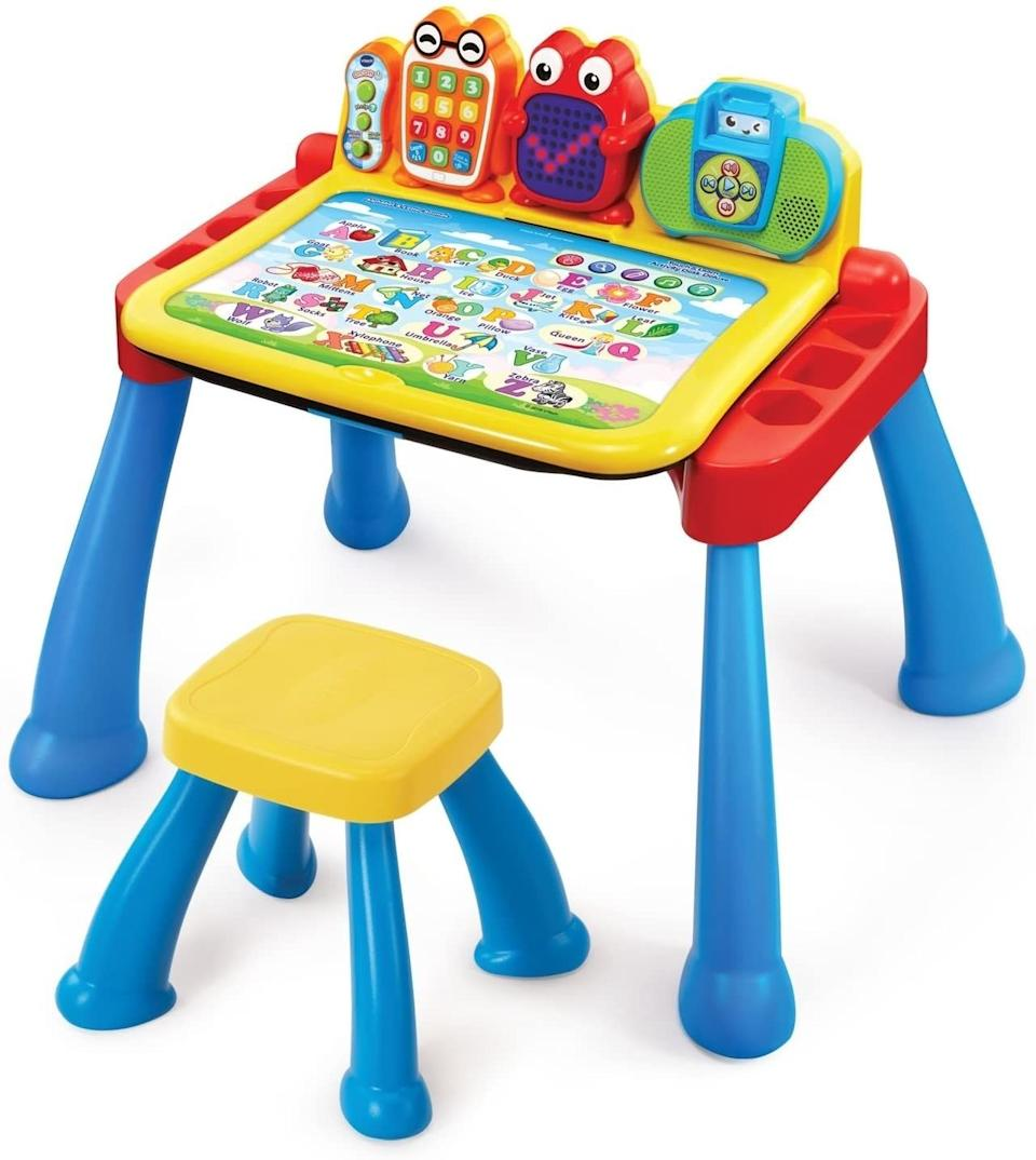 """With five interactive pages and more than 200 """"touch and learn spots"""" on each card — plus a music player, toy phone and LED light-up display — this desk is here for nonstop learning and playtime. Also, it transforms from a desk into an easel and chalkboard for more lo-fi fun.<br /><br /><strong>Promising review:</strong>""""I've had this for over a year and my son still plays with it.<strong>The key is to get the expansion pack to rotate the different activities.</strong>My son was a late talker (he's starting to pick it up), but one day he was playing with the desk and it would ask him to pick number x and he chose the number. He was consistently picking the right number. He wasn't talking yet but knew numbers 1 through 9. I was a little shocked because this was before we had to send him to daycare.<strong>Having the extra cards to change out keeps him interested and it helps reinforce what he's learning in school.</strong>It's the first thing he plays with when he gets home."""" —<a href=""""https://amzn.to/32DOlxz"""" target=""""_blank"""" rel=""""noopener noreferrer"""">Islandblue</a><br /><strong><br />Get it from Amazon for<a href=""""https://amzn.to/3ndCWhx"""" target=""""_blank"""" rel=""""noopener noreferrer"""">$69.90</a>.</strong>"""