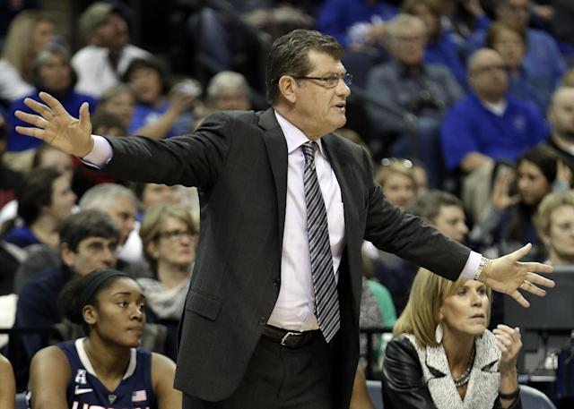 Connecticut head coach Geno Auriemma watches the action in the first half of an NCAA college basketball game against Memphis Saturday, Jan. 4, 2014, in Memphis, Tenn. (AP Photo/Mark Humphrey)
