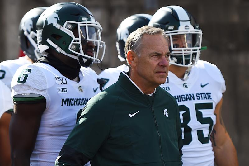 Head coach Mark Dantonio of the Michigan State Spartans takes the field with his team prior to a game against the Wisconsin Badgers (Getty)