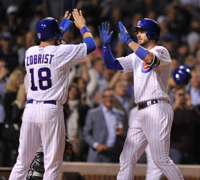Chicago Cubs' Kris Bryant (right) celebrates with teammate Ben Zobrist (left) at home plate. (AP)