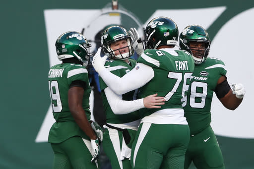 New York Jets quarterback Sam Darnold, second from left, reacts after running in a touchdown during the second half an NFL football game against the Las Vegas Raiders, Sunday, Dec. 6, 2020, in East Rutherford, N.J. (AP Photo/Noah K. Murray)