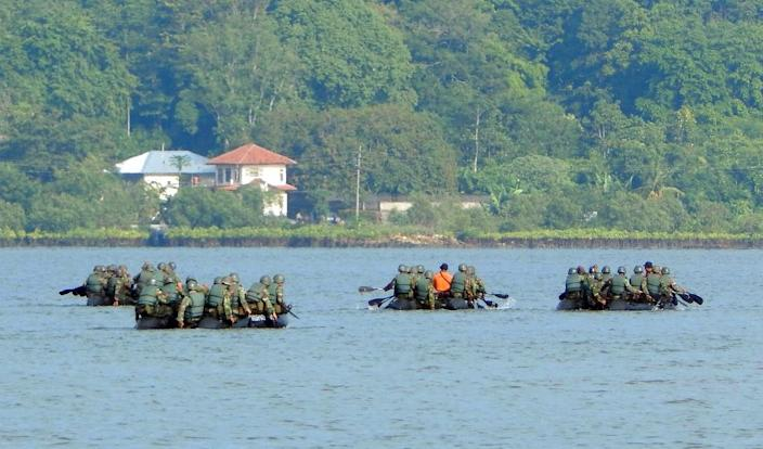 Indonesian troops conduct security exercise around Nusakambangan maximum security prison island, seen in the background, off central Java island, on April 24, 2015 (AFP Photo/Azka)