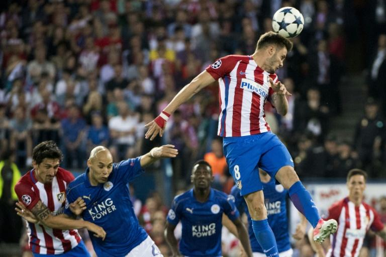 Atletico Madrid's midfielder Saul Niguez goes up for a header during the UEFA Champions League quarter final first leg football match against Leicester City April 12, 2017