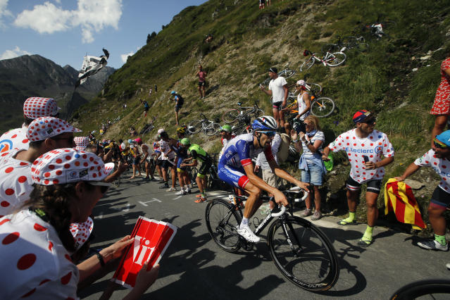 France's Thibaut Pinot climbs the Tourmalet pass during the fourteenth stage of the Tour de France cycling race over 117.5 kilometers (73 miles) with start in Tarbes and finish at the Tourmalet pass, France, Saturday, July 20, 2019. (AP Photo/ Christophe Ena)