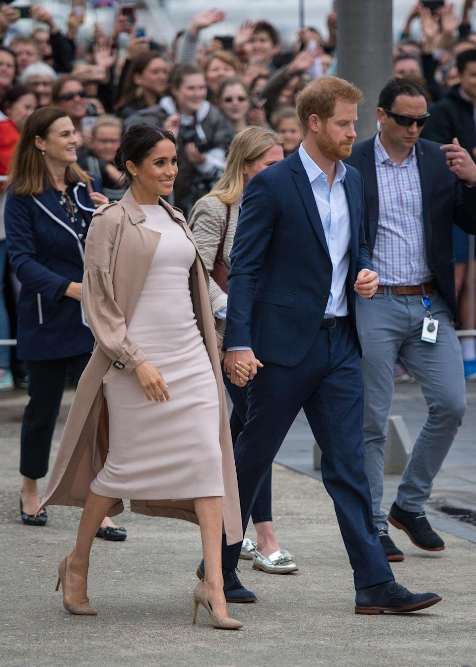 """<p>While in Auckland, Harry and Meghan greeted members of the public. The Ducehss paired a beige pencil dress by Brandon Maxwell with a Burberry trench and <a href=""""https://www.stuartweitzman.com/products/legend"""" rel=""""nofollow noopener"""" target=""""_blank"""" data-ylk=""""slk:Stuart Weitzman"""" class=""""link rapid-noclick-resp"""">Stuart Weitzman </a>pumps for the appearance.</p><p><a class=""""link rapid-noclick-resp"""" href=""""https://www.stuartweitzman.com/products/legend/"""" rel=""""nofollow noopener"""" target=""""_blank"""" data-ylk=""""slk:SHOP NOW"""">SHOP NOW</a> <em>Stuart Weitzman Legend Pumps, $375</em></p>"""