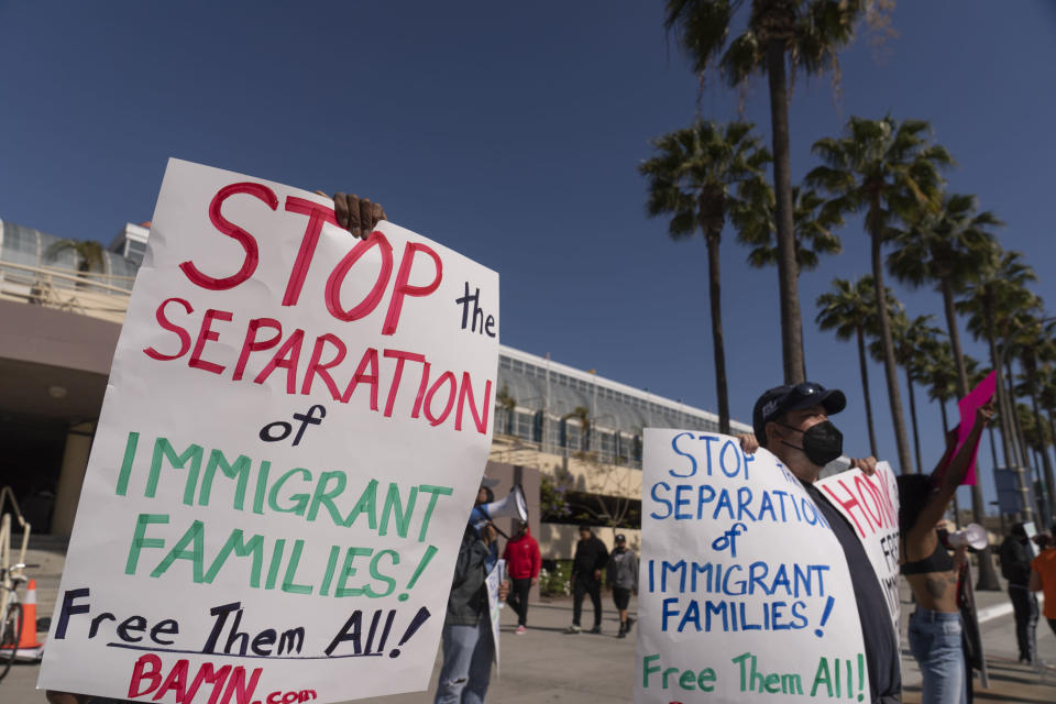 File— In this May 22, 2021 file photo, members of the Coalition to Defend Affirmative Action, Integration and Immigrant Rights, and Fight for Equality By Any Means Necessary, known as By Any Means Necessary (BAMN), hold a rally to demand the freedom of immigrant children in detention at a temporary shelter facility at the Long Beach Convention Center in Long Beach, Calif. U.S. Officials are closing four emergency facilities, two in Texas and two in California, set up to house migrant children caught crossing the border alone. But officials, Tuesday, June 29, 2021, cautioned that minors continue to arrive on the southwest border despite the summer heat. (AP Photo/Damian Dovarganes, File)