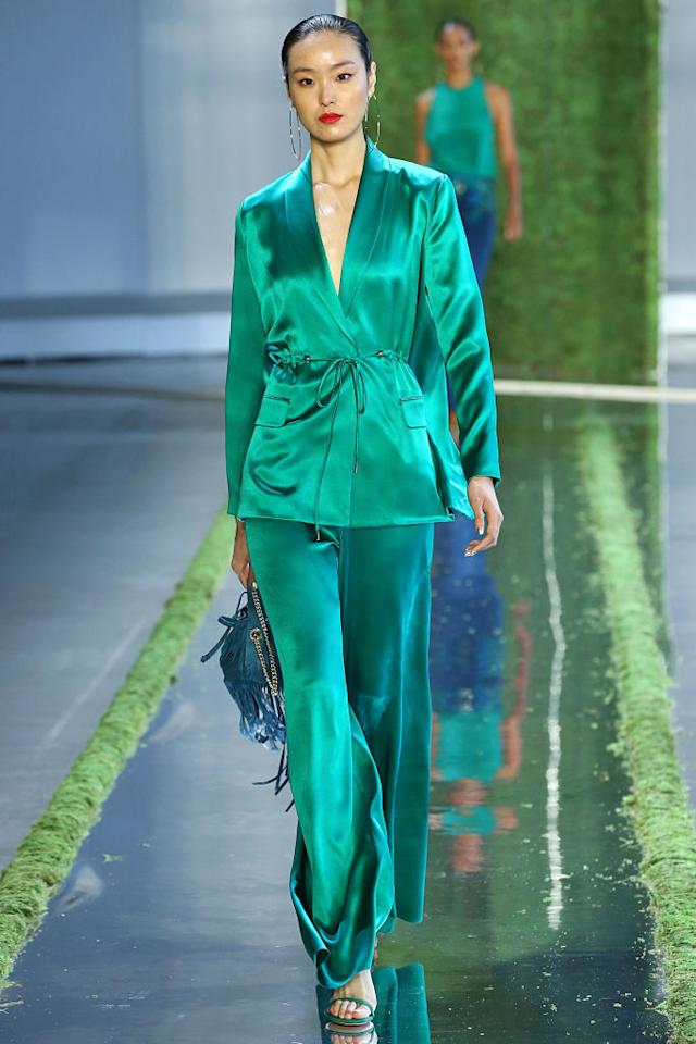 <p>There's no question that the Duchess of Sussex loves a great suit. She's worn versions from Altuzarra and Givenchy already, but this bright emerald number from Cushnie's Spring 2019 show would be a perfect match for Meghan. (Photo: Getty Images) </p>