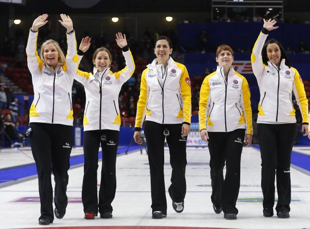 Manitoba skip Jennifer Jones (L-R) third Kaitlyn Lawes, second Jill Officer, lead Dawn McEwen and alternate Jennifer Clark-Rouire walk down the ice after they defeated Alberta to win the gold medal game during the Scotties Tournament of Hearts in Moose Jaw, Saskatchewan, February 22, 2015. REUTERS/Todd Korol (CANADA - Tags: SPORT CURLING)