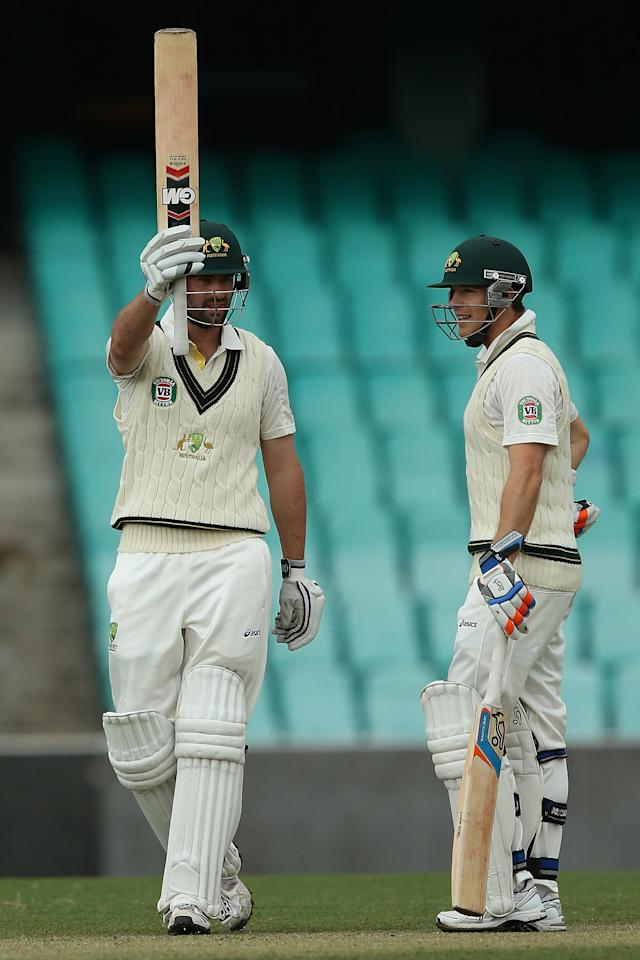 SYDNEY, AUSTRALIA - NOVEMBER 03:  Alex Doolan of Australia A celebrates his century with team mate Tim Paine during day two of the International TOur Match between Australia A and South Africa at Sydney Cricket Ground on November 3, 2012 in Sydney, Australia.  (Photo by Chris Hyde/Getty Images)