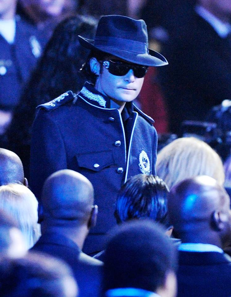 """Corey Feldman paid homage to MJ by donning a military-style jacket and black fedora. The actor befriended the superstar in the '80s at the heights of their fame. Mark Terrill-Pool/<a href=""""http://www.gettyimages.com/"""" target=""""new"""">GettyImages.com</a> - July 7, 2009"""