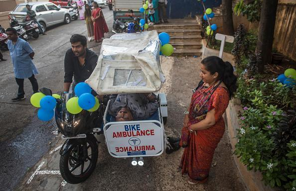 Bike-Ambulance launched by Lodha Foundation at Tejpal Hall, Grant Road in Mumbai, India. 24×7 bike ambulance services is equipped with a first-aid kit and oxygen cylinder and launched with aim to deal with medical emergencies amid heavy traffic. (Photo by Pratik Chorge/Hindustan Times via Getty Images)