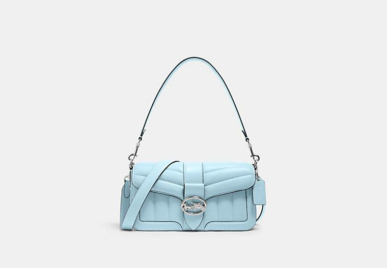 Product photo of baby blue Georgie Shoulder Bag With Puffy Quilting and silver hardware. Image via Coach Outlet.