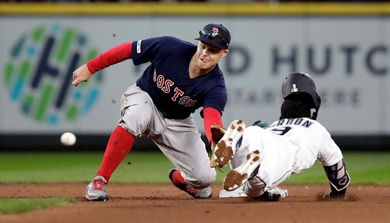 Red Sox utilityman Brock Holt is headed to the injured list after being poked in the eye by his young son. (AP Photo/Elaine Thompson)