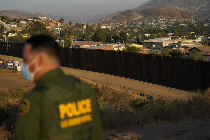 Border Patrol agent Justin Castrejon looks out along newly replaced border wall sections Thursday, Sept. 24, 2020, near Tecate, Calif. / Credit: Gregory Bull / AP