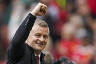 Manchester United's manager Ole Gunnar Solskjaer gestures to the crowd following the English Premier League soccer match between Manchester United and Leeds United at Old Trafford in Manchester, England, Saturday, Aug. 14, 2021. (AP Photo/Jon Super)