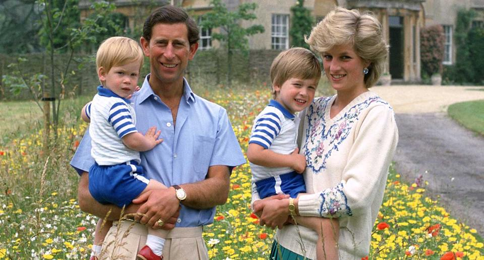 Prince Charles and Princess Diana holding their two children Prince William and Prince Harry