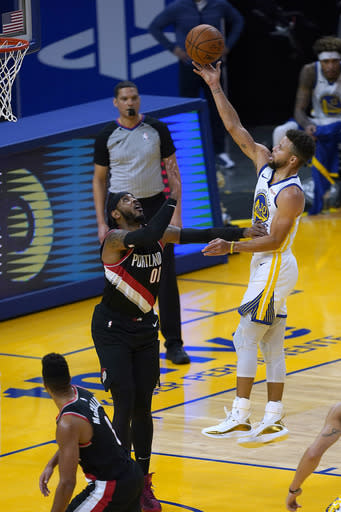 Golden State Warriors guard Stephen Curry (30) shoots over Portland Trail Blazers forward Carmelo Anthony (00) during the first half of an NBA basketball game in San Francisco, Friday, Jan. 1, 2021. (AP Photo/Tony Avelar)