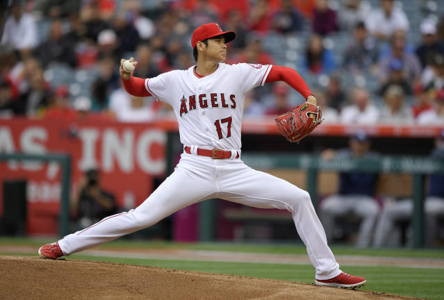 Los Angeles Angels starting pitcher Shohei Ohtani, of Japan, throws to the plate during the first inning of a baseball game against the Tampa Bay Rays Sunday, May 20, 2018, in Anaheim, Calif. (AP Photo/Mark J. Terrill)