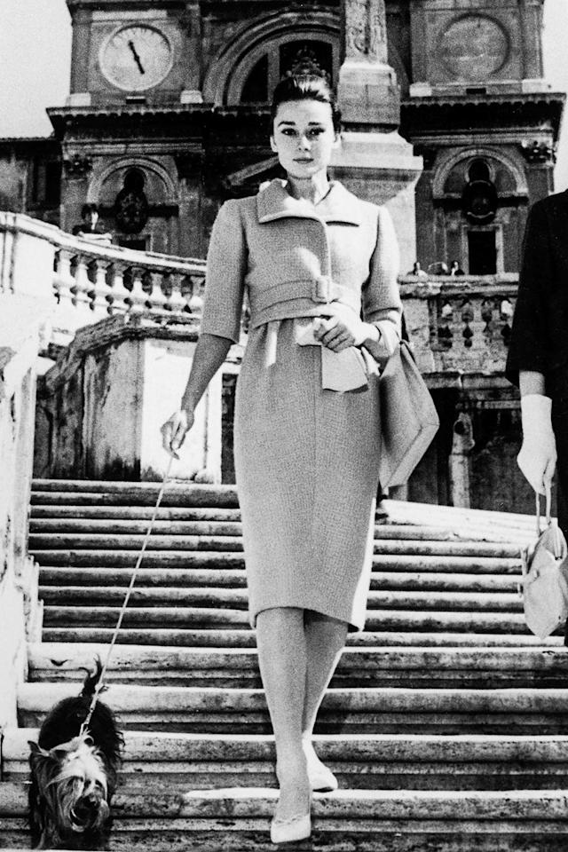 "<p>As a woman who once said, ""I believe in overdressing,"" Hepburn's polished look while walking her dog in Rome seems fitting.</p>"