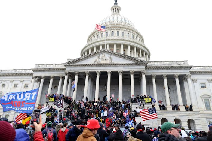 "Protesters gather on the U.S. Capitol Building on January 06, 2021 in Washington, DC.<span class=""copyright"">Tasos Katopodis/Getty Images</span>"