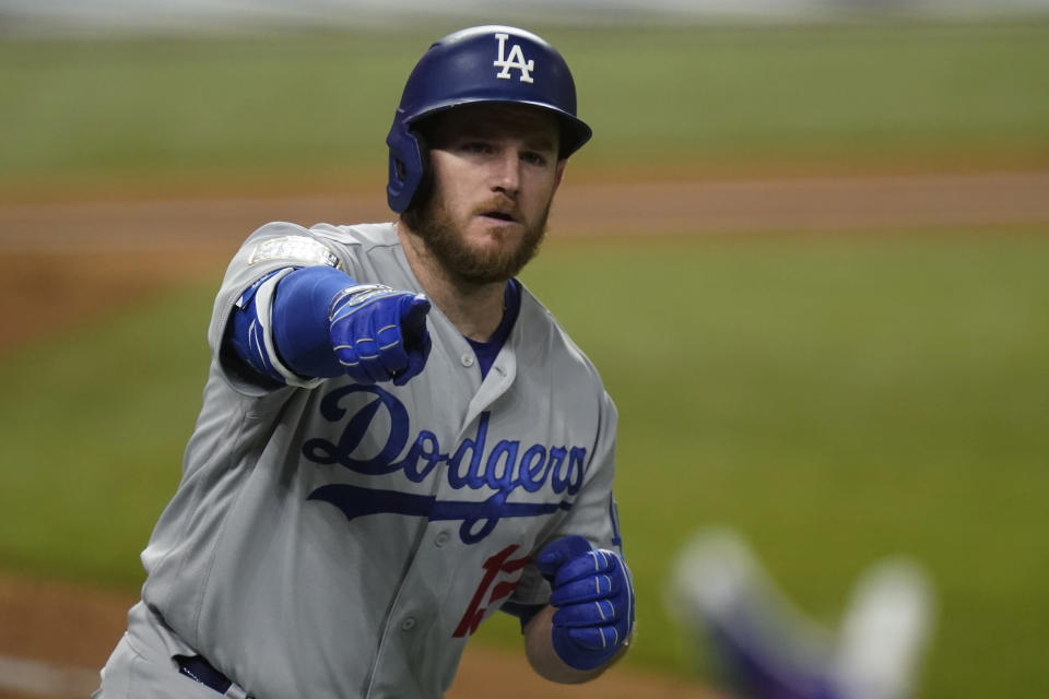 Los Angeles Dodgers first baseman Max Muncy celebrates a home run against the Tampa Bay Rays during the fifth inning in Game 5 of the baseball World Series Sunday, Oct. 25, 2020, in Arlington, Texas. (AP Photo/Eric Gay)