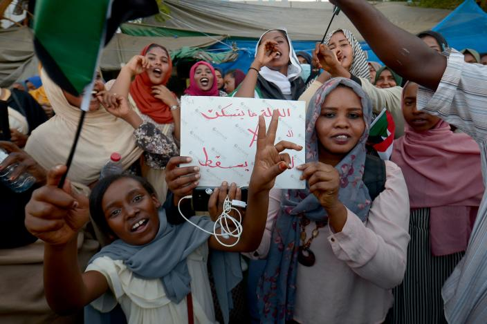 Sudanese demonstrators gather during a rally demanding a civilian body to lead the transition to democracy, in the Sudanese capital Khartoum on April 13, 2019. - Sudan's new military leader General Awad Ibn Ouf resigned late on April 12 just a day after being sworn in, as the country's army rulers insisted they would pave the way for a civilian government. (Photo by MOHAMMED HEMMEAIDA / AFP)        (Photo credit should read MOHAMMED HEMMEAIDA/AFP/Getty Images)