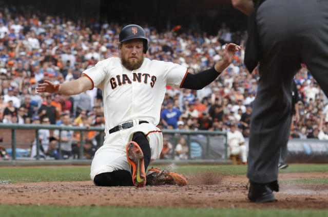 San Francisco Giants' Hunter Pence (8) scores to tie the game against the Los Angeles Dodgers during the fifth inning of a baseball game in San Francisco, Saturday, Sept. 29, 2018. (AP Photo/Jim Gensheimer)
