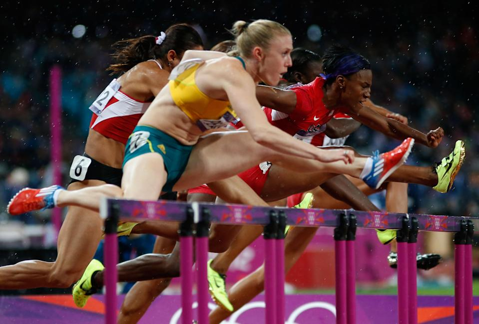 LONDON, ENGLAND - AUGUST 07: Sally Pearson of Australia leads Nevin Yanit of Turkey and Kellie Wells of the United States during the Women's 100m Hurdles Final on Day 11 of the London 2012 Olympic Games at Olympic Stadium on August 7, 2012 in London, England. (Photo by Jamie Squire/Getty Images)