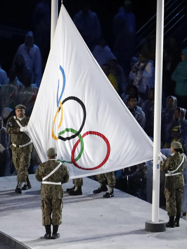 <p>The Olympic flag is lowered during the closing ceremony in the Maracana stadium at the 2016 Summer Olympics in Rio de Janeiro, Brazil, Sunday, Aug. 21, 2016. (AP Photo/Chris Carlson) </p>