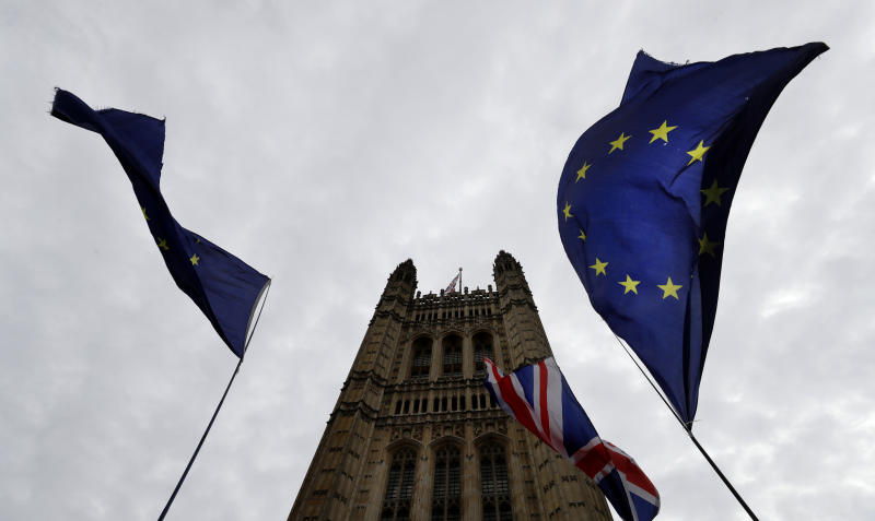 A European Union flag flies near Parliament in London, Tuesday, Oct. 8, 2019. The British government said Tuesday that the chances of a Brexit deal with the European Union were fading fast, as the two sides remained unwilling to shift from their entrenched positions. (AP Photo/Kirsty Wigglesworth)