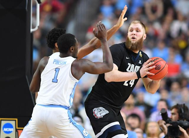 <p>Gonzaga Bulldogs center Przemek Karnowski (24) is defended by North Carolina Tar Heels forward Theo Pinson (1) in the first half in the championship game of the 2017 NCAA Men's Final Four at University of Phoenix Stadium. Mandatory Credit: Bob Donnan-USA TODAY Sports </p>