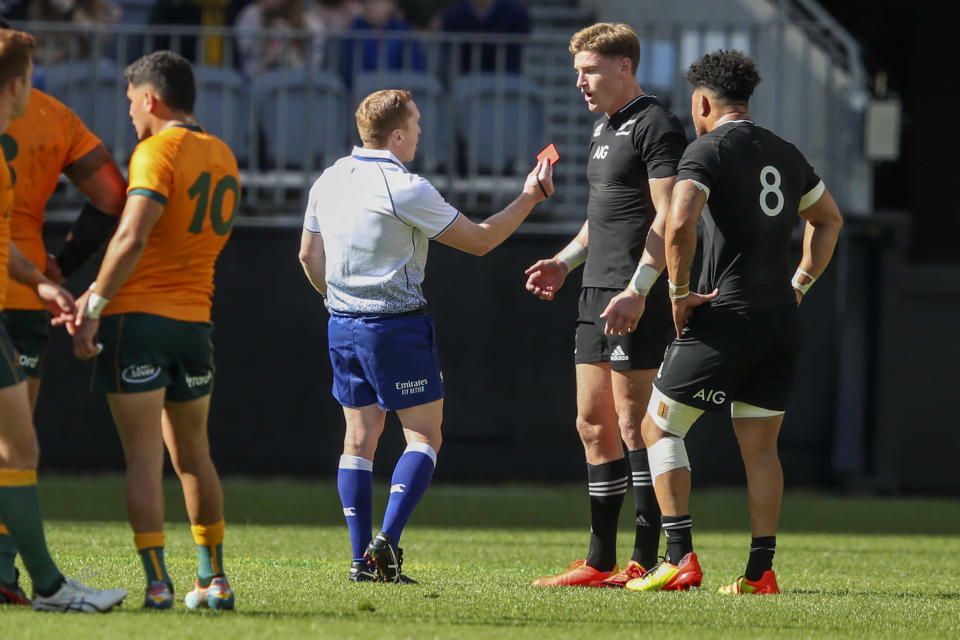 Referee Damon Murphy shows a red card to New Zealand's Jordie Barrett, second right, during the Rugby Championship game between the All Blacks and the Wallabies in Perth, Australia, Sunday, Sept. 5, 2021. (AP Photo/Gary Day)