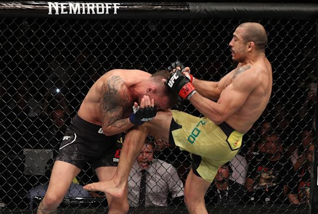 Jose Aldo knees Renato Moicano in their featherweight fight during the UFC Fight Night event at CFO Centro de Formacao Olimpica on Feb. 2, 2019, in Fortaleza, Brazil. (Getty Images)