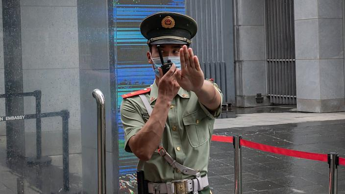 A Chinese police officer makes a gesture