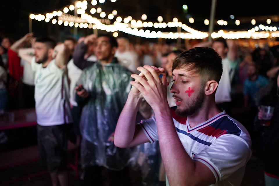 England fans at Luna Springs in Birmingham watching the penalty shoot out during the UEFA Euro 2020 Final between Italy and England. Picture date: Sunday July 11, 2021.