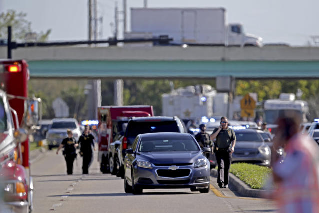 <p>Police and fire rescue vehicles converge on Stoneman Douglas High School following a shooting at Marjory Stoneman Douglas High School in Parkland, Fla., on Feb. 14, 2018. (Photo: John McCall/South Florida Sun-Sentinel via AP) </p>