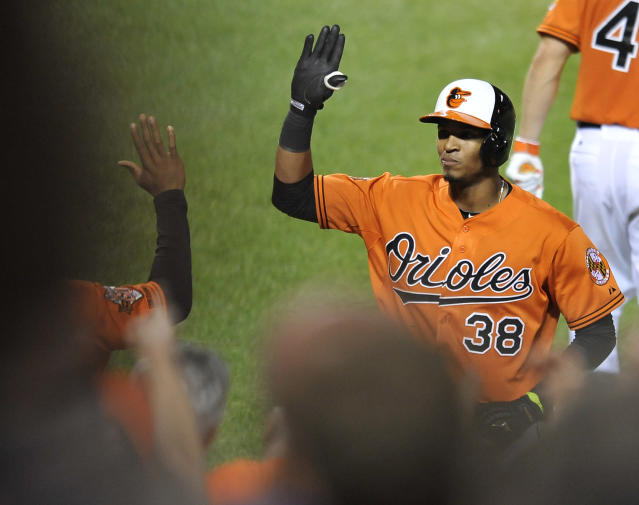 Baltimore Orioles' Jimmy Paredes is congratulated after hitting a solo home run against the Minnesota Twins in the sixth inning of a baseball game, Saturday, Aug. 30, 2014, in Baltimore. The Orioles won 3-2.(AP Photo/Gail Burton)