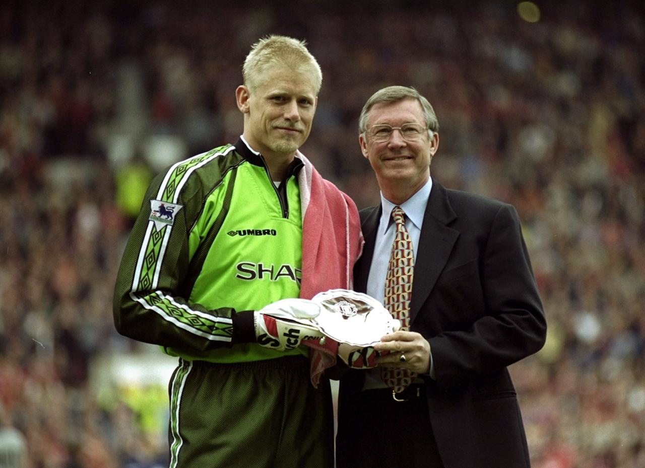 16 May 1999:  Peter Schmeichel of Manchester United is presented with an honour of service award by his manager Alex Ferguson before the FA Carling Premiership match against Tottenham Hotspur played at Old Trafford in Manchester, England.  The match finished in a 2-1 win for Manchester United and they clinched their 5th Premiership title in seven years. \ Mandatory Credit: Shaun Botterill /Allsport