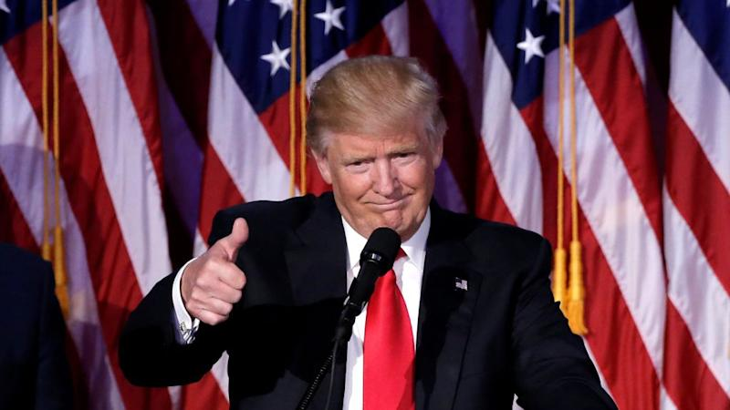US President-elect Donald Trump gestures as he speaks at election night rally in Manhattan, New York, US