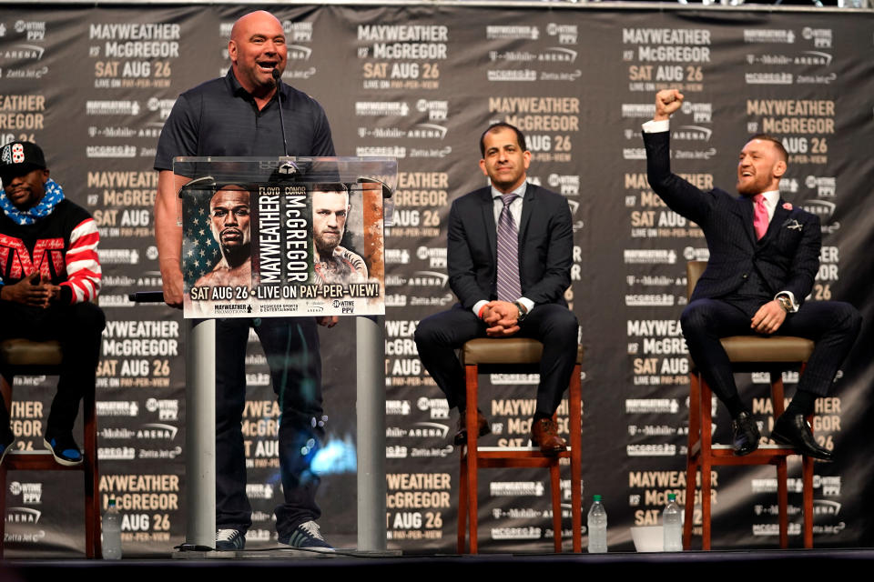 LOS ANGELES, CA - JULY 11:  (L-R) UFC President Dana White introduces Conor McGregor during the Floyd Mayweather Jr. v Conor McGregor World Press Tour event at the Staples Center on July 11, 2017 in Los Angeles, California. (Photo by Jeff Bottari/Zuffa LLC/Zuffa LLC via Getty Images)