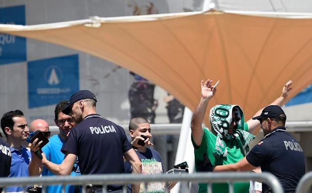 Sporting Lisbon fans frisked by police as they arrive at Saturday's AGM to vote for the crisis-club president's resignation (AFP Photo/MIGUEL RIOPA)