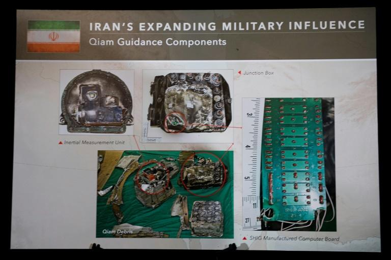 A placard shows parts of the guidance system to an Iranian Qiam Ballistic Missile on display